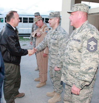 Delaware Governor Jack Markell, left, meets Delaware Airmen at Bagram Air Base, Afghanistan on Nov. 16, 2011. To the left of the governor is Col. Mike Feeley (tan flight suit), deputy operations group commander, 455th Air Expeditionary Wing, Bagram Air Base, Afghanistan, and commander, 166th Operations Group, 166th Airlift Wing, Delaware Air National Guard in New Castle, Delaware. Governor Markell and Connecticut Governor Dannel Malloy spent a day in one nation in Southwest Asia and two days in Afghanistan meeting troops from their respective states. (Courtesy photo/Delaware office of the governor)