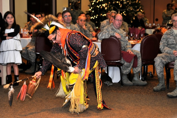 Tech. Sgt. Thundercloud Hirajeta performs a southern plains war dance during the Native American Heritage Month luncheon at the Recce Point Club Beale Air Force Base, Calif. Nov 29, 2011  Hirajeta is representing the Comanche people. (U.S. Air Force photo by Staff Sgt. Jeremy McGuffin/Released)