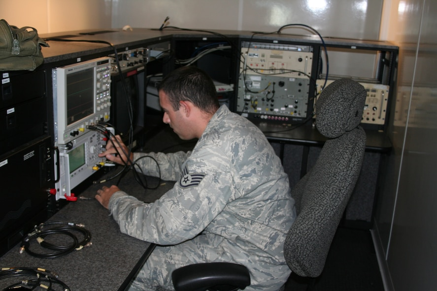 Staff Sgt. Phillip Graves, 346th Test Squadron, calibrates equipment for radio frequency emission testing here Oct. 4. (U.S. Air Force photo by Senior Airman James Barker)