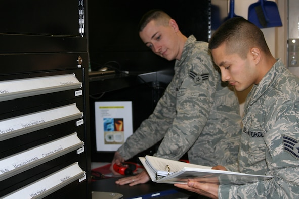Senior Airman Steven Craig and Staff Sgt. Bruce Woo, 346th Test Squadron, verify network security settings for an Air Force-level test here Oct. 4. The unit tests hardware and software for units within 24th Air Force, Air Force Space Command, the Air Force and the Defense Information Systems Agency. (U.S. Air Force photo by Senior Airman James Barker)