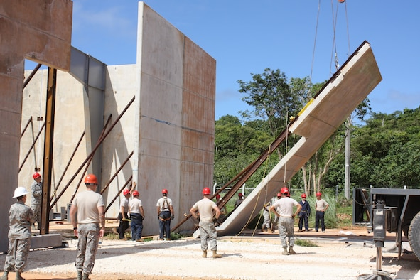 ANDERSEN AIR FORCE BASE, Guam- A pre-cast tilt-up panel is lifted by a crane to be put into place during construction of the vertical special capabilities warehouse, Nov. 22. The VSC is a one year project being built with pre-cast tilt-up panels, and when complete the building will be a storage for specialized construction equipment. (U.S. Air Force photo courtesy photo)
