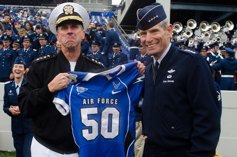 Air Force Chief of Staff Gen. Norton Schwartz has the Chief of Naval Operations Adm. Jonathan Greenert pose with a Falcons jersey to after the Falcons beat the Midshipmen of Navy Saturday, Oct. 1, 2011 at the Naval Academy's Jack Stephens Field. The Falcons dominated the first half, but almost let go of the game in the second after the Mids outscored them 25-7. The Falcons won 35-34 in overtime after Falcon linebacker Alex Means' block of Mids kicker Jon Teague point-after attempt. (U.S. Air Force photo/Russ Scalf)
