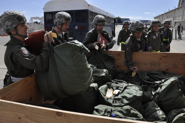California Air National Guardsmen with the 130th Rescue Squadron grab deployment bags while participating in a Phase 1 Operational Readiness Exercise at Moffett Federal Airfield, Calif., Oct. 1, 2011.  (Air National Guard photo by Airman 1st Class John Pharr)