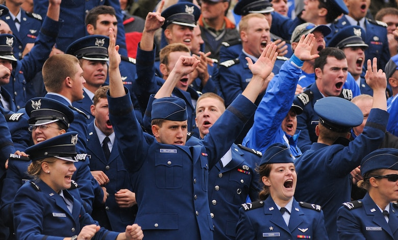 Air Force cadets celebrate the game winning point-after attempt block in overtime as the Falcons beat the Midshipmen of Navy Saturday, Oct. 1, 2011 at the Naval Academy's Jack Stephens Field. The Falcons dominated the first half, but almost let go of the game in the second after the Mids outscored them 25-7. The Falcons won 35-34 in overtime after Falcon linebacker Alex Means' block of Mids kicker Jon Teague point-after attempt. (U.S. Air Force photo/Russ Scalf)