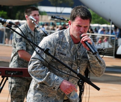 """PRETORIA, South Africa - Staff Sgt. Craig Bowman, U.S. Air Forces Europe Band """"Top 'n Go"""" lead singer, performs a song during the 2011 Air Show & Lifestyle Expo at Waterkloof Air Force Base, Oct. 1. The six-person band has been traveling and performing all over the Pretoria area since their arrival last week. (U.S. Air Force photo by Tech. Sgt. Todd Wivell)"""