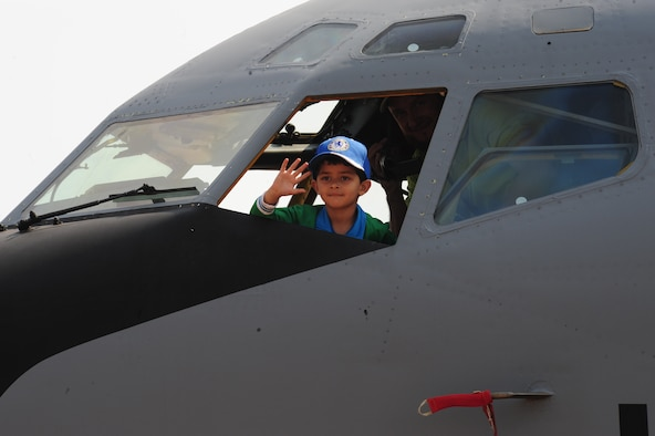 PRETORIA, South Africa - A young South African child sits aboard a KC-135 during the 2011 Air Show and Lifestyle Expo at Waterkloof Air Force Base, Oct. 1. South Africans had an opportunity to climb aboard and sit in the cockpit of the KC-135 during their visit to this year's air show. (U.S. Air Force photo by Tech. Sgt. Todd Wivell)
