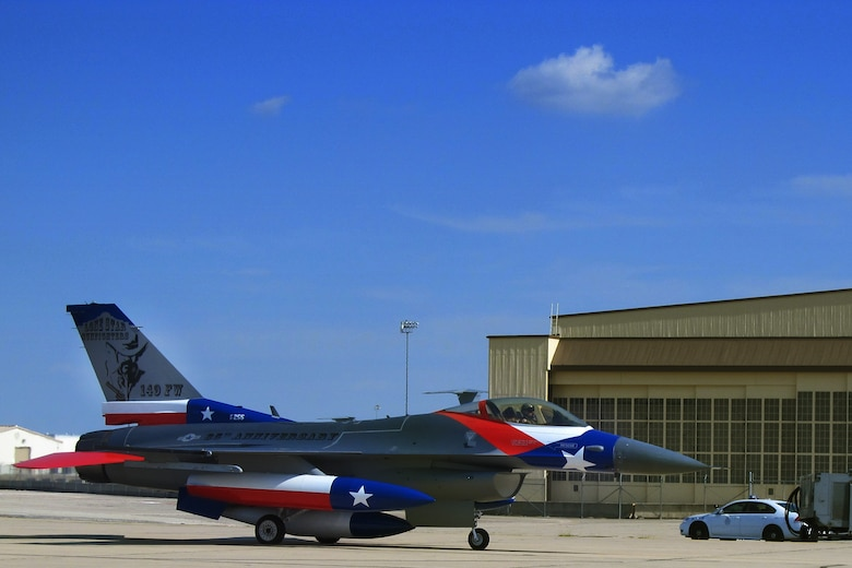The Texas Air National Guard's 149th Fighter Wing's flagship F-16 returning to Lackland Air Force Base after being painted to honor the 65th anniversary of the unit's affiliation with the Air National Guard, Sept. 29, 2011. (Air National Guard photo by Staff Sgt. Phil Fountain/Released)