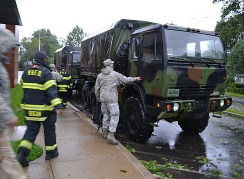 Air National Guard support to the joint response to Hurricane Irene was in full motion Saturday, Aug. 27, 2011, as several Soldiers and Airmen rolled out in multiple cities to support civilian authorities. (Photo courtesy of 103rd ACS UPAR)
