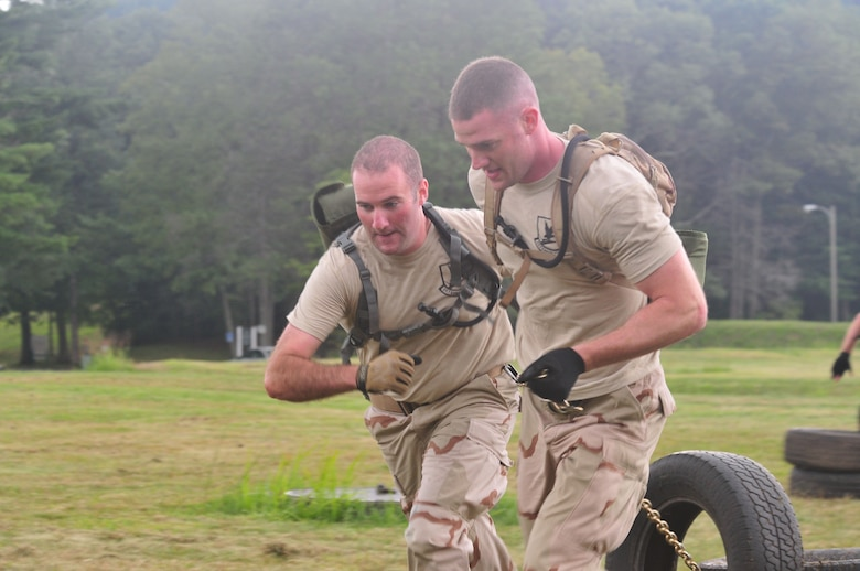 Staff Sgt. Ray Ryan (left) and Staff Sgt. Brian Davies, both from the 103rd Security Forces Squadron, pull more than just their own weight as members of the Connecticut Air National Guard Emergency Service Team during a Connecticut SWAT Challenge event at the West Hartford MDC Reservoir Aug. 25, 2011. The Guard team took 22nd place overall in the annual competition. (U.S. Air Force photo by Tech. Sgt. Erin McNamara)