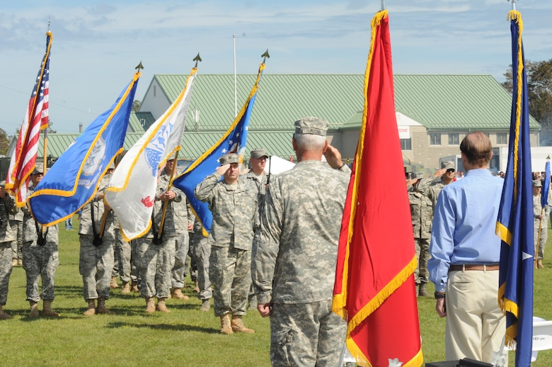 Connecticut Guardsmen salute during a ceremony as part of the Connecticut National Guard's Family Day at Camp Niantic, Niantic, Conn. Sept. 10, 2011. The ceremony was held to honor recent deployers from the Connecticut National Guard. (U.S. Air Force photo by Tech. Sgt. Tedd Andrews)
