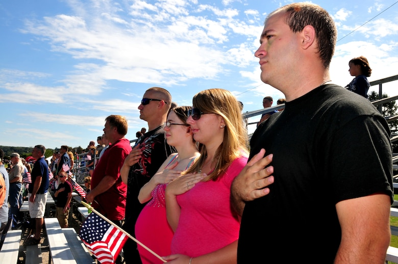 Army Pvt. Thomas Case, assigned to the 192d Engineers Co., and Army Pvt. Mark McCotter, assigned to the 1048th Medium Truck Co., stand during the playing of the National Anthem during a ceremony as part of the Connecticut National Guard's Family Day at Camp Niantic, Niantic, Conn. Sept. 10, 2011. (U.S. Air Force photo by Tech. Sgt. Tedd Andrews)