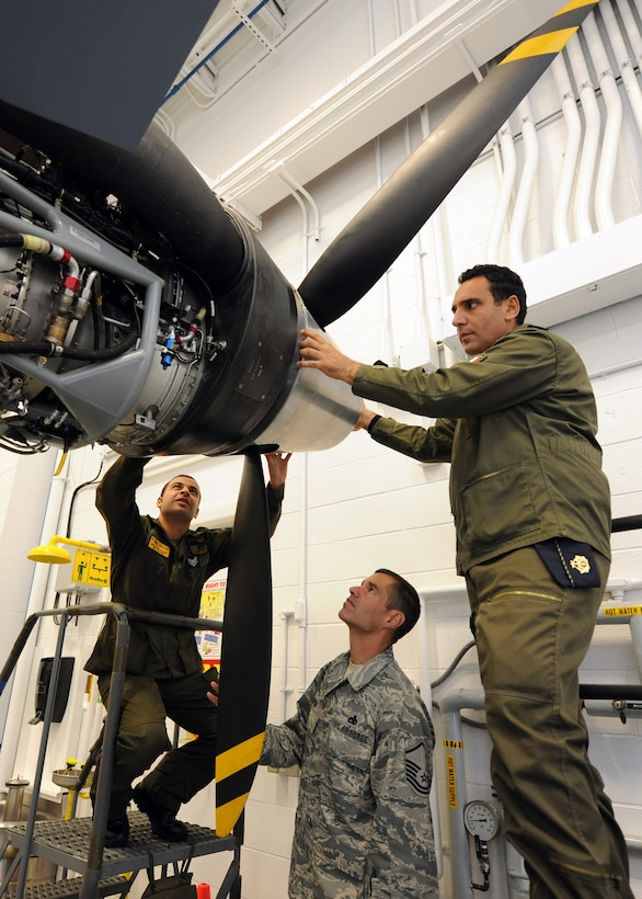 Italian Air Force Chief Warrant Officer Lorenzo Scafuto and Staff Sgt. Marco Redavide work together on a MQ-9, while receiving feedback from their instructor Master Sgt. Scott Simpson at the Field Training Detachment (FTD) in Syracuse NY, on 20 Sept 2011.  Scafuto and Redavide are the first Italian Air Force members to receive formal maintenance training on the MQ-9.  They are part of the 100th graduating class from the 174 FW FTD, which is the sole formal MQ-9 maintenance training facility in the U.S. Air Force. (Photo by Staff Sgt Ricky Best)
