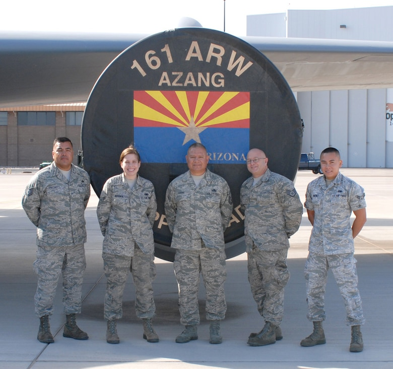 (From left) Technical Sgt. Ramiro Pacheco, Airman 1st Class Jenna Booska , Master Sgt.  Marty Corona, Staff Sgt. David Joseph , and Airman 1st Class Kevin Gimenez, 161st Maintenance Group crew chiefs, stand with their KC-135r, Phoenix, October 2011. This aircraft flew 1,070 flight hours during fiscal year 2011; aside from air refueling, missions include transporting passengers and cargo, proving to be a major contributor to mission success. (Air Force photo by A1C Rashaunda Williams/Released)