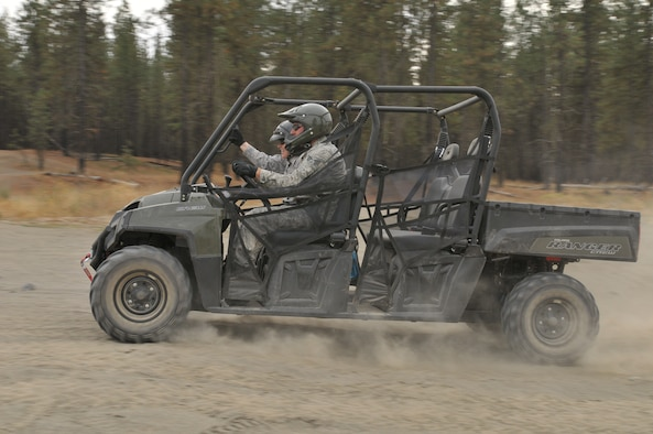 Tech. Sgt. Cynthia L. LaForce and Senior Airman Jason H. Clark from the 141st Force Support Squadron speed through an obstacle course in a new Polaris Ranger all-terrain vehicle at Seven Mile off-road vehicle Park Oct. 1 near Spokane, Wash.  The Polaris vehicles are part of the Fatality Search and Recovery Team and will be used to recover victims of natural and manmade disasters.  (U. S. Air Force Photo by Tech. Sgt. Travis S. Metheny/Released)