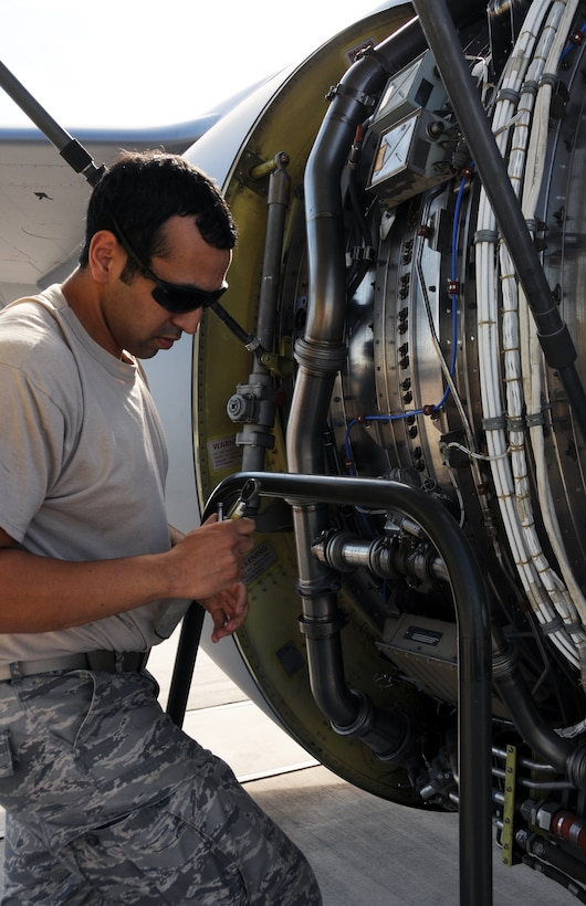 Senior Airman Guadalupe Retana, 161st Maintenance Group engine mechanic, changes out the ignition exciter box on a KC-135r as part of a routine maintenance inspection, Phoenix, Oct. 1, 2011. This scheduled maintenance includes checking all four engines, changing filters and ensuring there aren't any oil or fuel leaks. (U.S. Air Force Photo by Staff Sgt. Courtney Enos/Released)