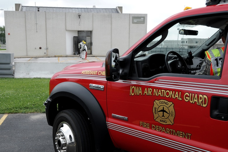 Members of the 132nd Fighter Wing (132FW) Fire Department conduct training in a simulated structure fire at the 132FW, Des Moines, Iowa on June 11,2011.  (US Air Force Photo/Staff Sgt. Linda E. Kephart)(Released)