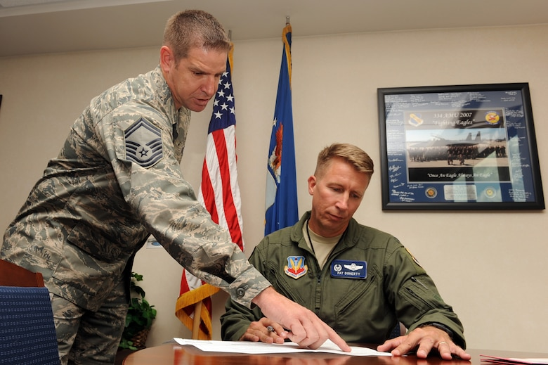 Senior Master Sgt. Michael Jenkins, 4th Medical Operations Squadron superintendant, reviews Colonel Patrick Doherty, 4th Fighter Wing (FW) commander, bone marrow consent form at Seymour Johnson Air Force Base, N.C., during bone marrow drive, Sept. 27, 2011. The bone marrow drive is searching for a donor match for an Army sergeant's daughter who is fighting leukemia. Doherty is a native of Lincoln, Neb. and Jenkins is a native of Lakeland, Fla. (U.S. Air Force photo by Senior Airman Whitney Stanfield)