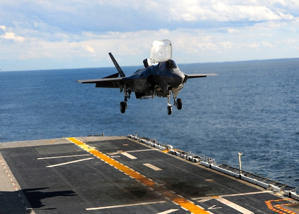 The F-35B Lightning 11 prepares to vertically land for the first time at sea on the flight deck of the amphibious assault ship USS Wasp (LHD 1). The F-35B is the Marine Corps Joint Strike  Force variant, designed for short takeoff and vertical landing on Navy amphibious ships. The purpose of F-35B sea trials on USS Wasp (LHD-1) is to test F-35B systems and ship's support functions.::r::::n::