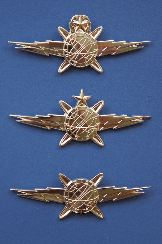 From bottom: The Air Force Academy's basic, senior and master cyberwarfare badges. (U.S. Air Force photo/Maj. Patrick Baldwin)