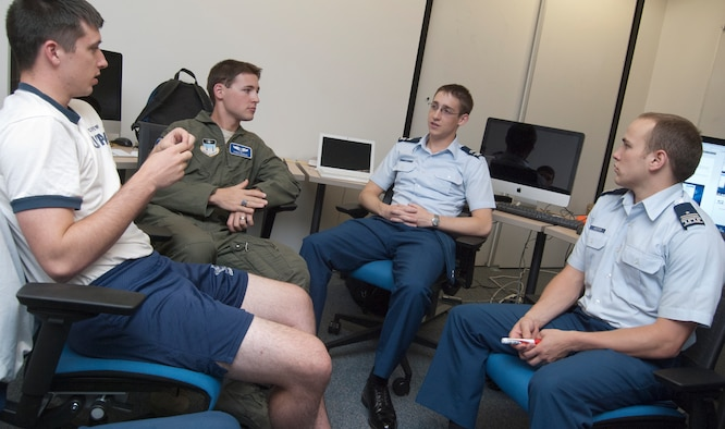 From left: Cadet 2nd Class Josh Christman, Cadet 1st Class Chris Shields, Cadet 2nd Class Nathan Hart and Cadet 1st Class Jordan Keefer discuss buffer overflow exploits during a cyber competition team meeting in the Air Force Academy's Cyberwarfare Lab Oct. 3, 2011. The team placed third out of 45 U.S. undergraduate teams in a competition hosted by the New York University Polytechnic Institute Sept. 23-25. Keefer is the team's cadet in charge. (U.S. Air Force photo/Don Branum)