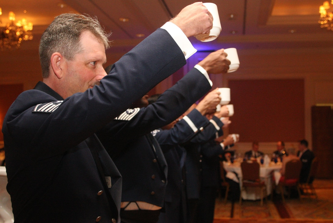 "Members of the 94th Airlift Wing Honor Guard take their turn at the grog raising a cup ""to the mess"" at the 94th Airlift Wing Dining Out held in downtown Atlanta, Ga., Oct. 1. (U.S. Air Force photo/Don Peek)"
