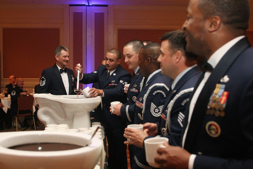 Members of the 94th Airlift Wing Honor Guard take their turn at the grog during the 94th Airlift Wing Dining Out held in downtown Atlanta, Ga., Oct. 1. (U.S. Air Force photo/Don Peek)