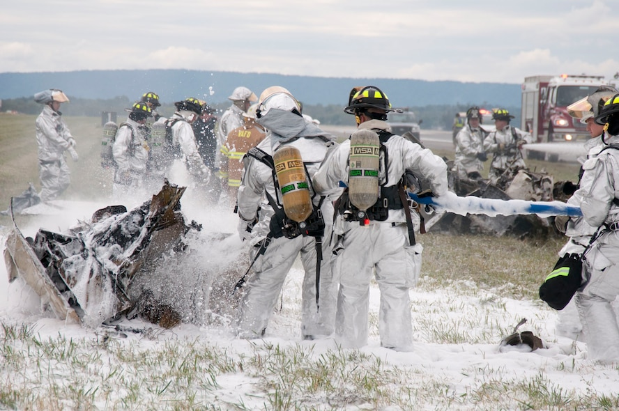 First responders from the 167th Fire Department and Security Forces Squadron respond to an aircraft crash and begin recovery operations in conjunction with civilian agencies on September 17, 2011 during an open house and air show at the 167th Airlift Wing in Martinsburg West Virginia. A T-28 aircraft performing with the Trojan Horseman crashed several minutes into the performance. There were no injuries on the ground. (National Guard photo by Staff Sgt. Michael Dickson)