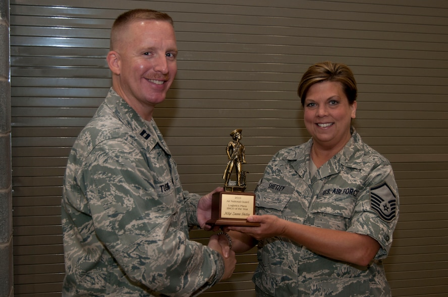 Master Sgt. Zoe Shetley receives her Air National Guard Logistics Plans Senior NCO of the Year trophy from Capt. Chris Tusing on Sunday, June 5, 2011. Shetley, with over 17 years of experience in logistics, was nominated for the award by Capt. Tusing. (National Guard photo by Staff Sgt. Michael Dickson)