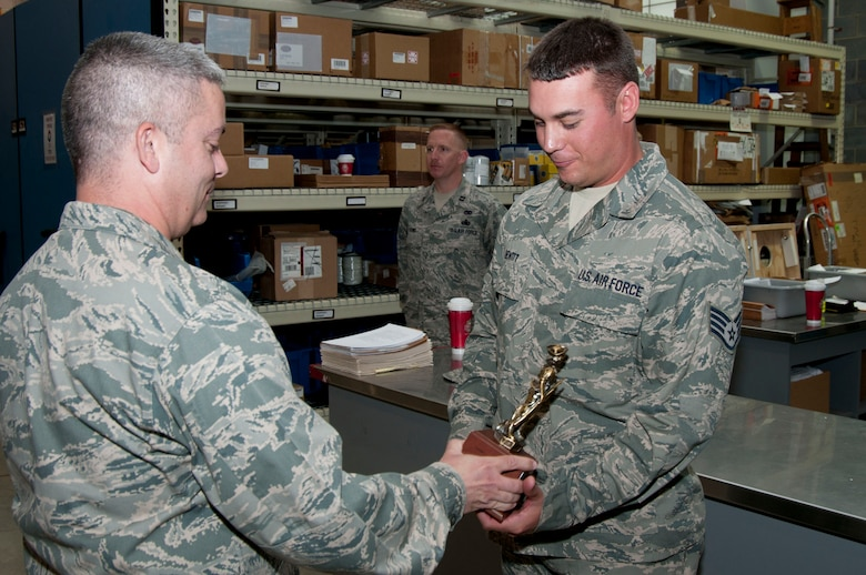 Staff Sgt. Michael Hewitt receives the Air National Guard Traffic Management NCO of the Year trophy from Maj. Charles Nassar Sunday, June 5, 2011. Hewitt was nominated for the award by Senior Master Sgt. Floyd Angelo. (National Guard photo by Staff Sgt. Michael Dickson)