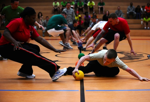 SPANGDAHLEM AIR BASE, Germany -- Players rush for dodgeballs during the Combined Federal Campaign dodgeball tournament kick off here Oct. 4. Twenty-one teams participated in the tournament and raised $586 for the CFC, an annual campaign that enables federal employees to make donations to a number of federally-approved charitable organizations. (U.S. Air Force photo/Staff Sgt. Nathanael Callon)