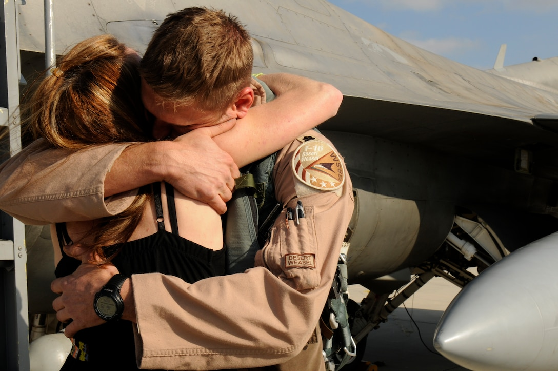 SPANGDAHLEM AIR BASE, Germany -- Lt. Col. Aaron Piepkorn, 480th Fighter Squadron F-16 pilot, hugs his wife, Bo, here after returning from a six-month deployment Oct. 4. The pilots are returning from their deployment to Iraq in support of Operation New Dawn. (U.S. Air Force photo/Airman 1st Class Brittney Frees)