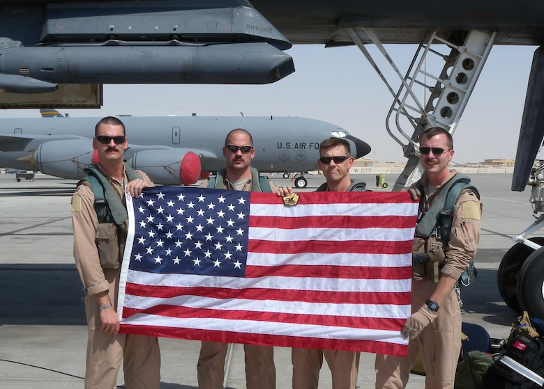 A 34th Expeditionary Bomb Squadron crew who flew a mission Sept. 11, 2011.  34th EBS Commander Lt. Col. John Martin is third from left.