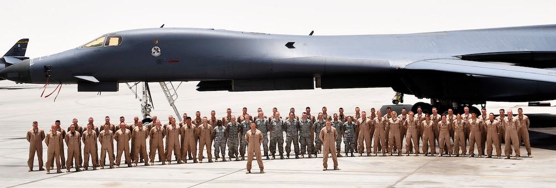 The 34th Expeditionary Bomb Squadron poses for a photograph with a B-1B Lancer at an undisclosed location in Southwest Asia.