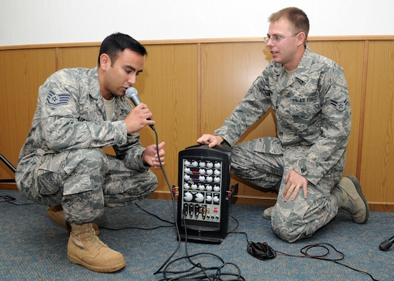 SPANGDAHLEM AIR BASE, Germany – Staff Sgt. Reynaldo Ulibarri and Airman 1st Class Douglas Young, 52nd Communication Squadron radio frequency transmission system technicians, conduct an operations check on a portable public-address system here Oct. 4. The communication squadron's PA system is used in support of 52nd Fighter Wing official functions. The work of the 52nd CS allows different units to communicate effectively to achieve the Saber mission. (U.S. Air Force photo/Senior Airman Christopher Toon)