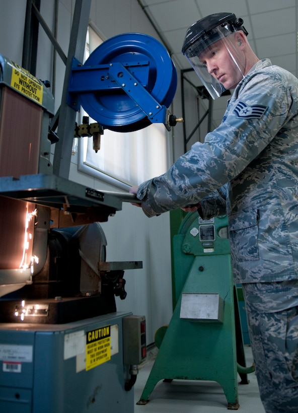 Staff Sgt. Robby Worley, 39th Maintenance Squadron aircraft structural maintenance craftsman, grinds a pipe on a belt sander Oct. 4, 2011, at Incirlik Air Base, Turkey. The maintenance squadron is responsible for welding and sheet metal fixes, directing aircraft to where it will be parked, crash response capabilities, providing lighting and generators, and many other duties. The 39th MSX works as a back shop for the 728th Air Mobility Squadron's maintainers.(U.S. Air Force photo by Senior Airman Anthony Sanchelli/Released)