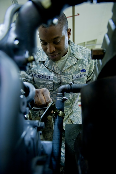 Staff Sgt. Clifton Hollonquest, 39th Maintenance Squadron aerospace ground equipment craftsman, inspects a new generator engine Oct. 4, 2011, at Incirlik Air Base, Turkey. The maintenance squadron is responsible for welding and sheet metal fixes, directing aircraft to where it will be parked, crash response capabilities, providing lighting and generators, and many other duties. The 39th MSX works as a back shop for the 728th Air Mobility Squadron's maintainers.(U.S. Air Force photo by Senior Airman Anthony Sanchelli/Released)