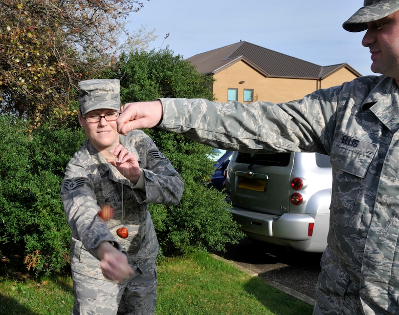 Staff Sgt Felicia Welch and Senior Airman Brian Ellis engage in a game of conkers. The game is played between two players taking turns striking their opponent's conker with their own. The intent is to hit the opponent's conker as hard as possible, inflicting damage on your opponent.The first recorded game of conkers dates back to 1848 on the Isle of Wight. Conkers are hard brown nuts found in a prickly case that fall from the tree when ripe. The origin of the name 'conker' is unclear but it's believed that it comes from the French word 'cogner' meaning to hit. ( Photo by A1C Perry Aston)