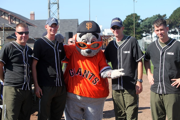 Marines with the 3rd Assault Amphibian Battalion pose with the San Francisco Giants mascot after taking on San Francisco firefighters, police officers and sailors in softball, Oct. 7, 2011. Marines and sailors from the USS Bonhomme Richard challenged the locals as part of the mission to strengthen ties between the military and civilian communities.
