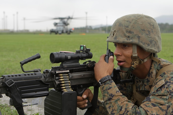 U.S. Marine Lance Cpl. Raul Elikhi, a cannoneer assigned to Kilo Battery, Battalion Landing Team, 2nd Battalion 7th Marines, 31st Marine Expeditionary provides security during Humanitarian Aid, Disaster Relief training mission on Camp Hansen, Okinawa, Japan, Oct 9, 2011. The Marines are conducting the training as part of the MEU's Certification Exercise (CERTEX). The MEU executes CERTEX prior to every deployment to ensure its capability of responding to a wide variety of contingencies. (U.S. Marine Corps photo by Lance Cpl. Vernon T. Meekins/Released)