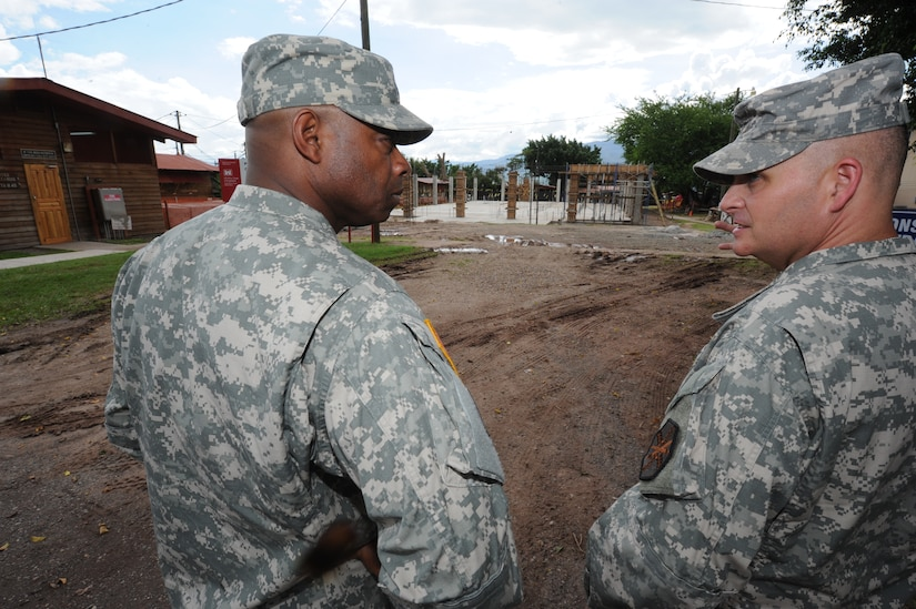 Maj. Gen Reuben D. Jones, (left) deputy commanding general for operations, U.S. Army Installation Management Command, talks with Col. Barry Graham, Army Support Activity commander, about the construction of a gym Oct. 3, 2011, at Soto Cano Air Base, Honduras. (U.S. Air Force photo/Tech. Sgt. Matthew McGovern)