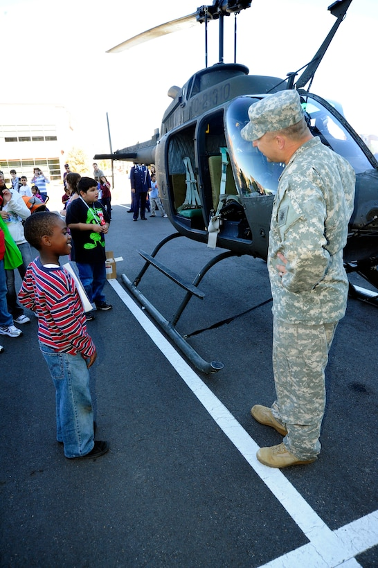 Elementary school children speak with a Soldier and get a close-up view of a Colorado National Guard OH-58 Kiowa helicopter at a Red Ribbon Week event in 2009. (U.S. Air Force photo by Staff Sgt. Nicole Manzanares, Colorado Air National Guard)
