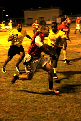 Seth P. Stringham, Blue Falcon's wide reciever, runs an intercepted ball during a 2011 intramural flag football game at Penny Lake Fields here Oct. 12. Plays like Stringham's interception gave the Blue Falcons the edge needed to earn the win.
