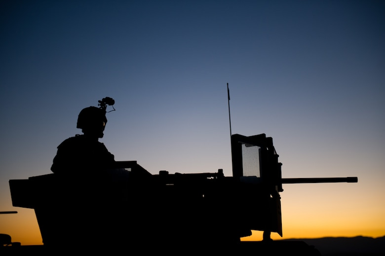 A Marine with Battalion Landing Team 3/1 keeps watch during a security halt before conducting a training raid here Oct. 11. The reinforced battalion is the ground-combat element for the 11th Marine Expeditionary Unit, which conducted its final exercise Sept. 28 to Oct. 12 before deploying in November.