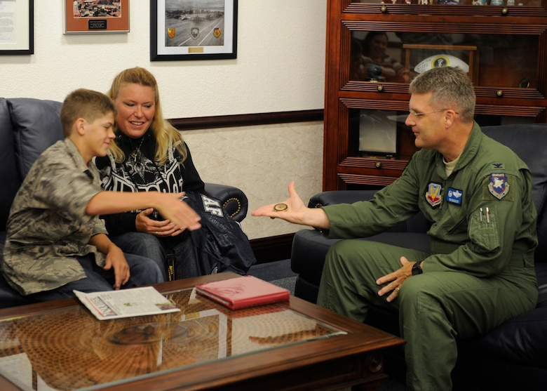 Col. Ron Buckley, 366th Fighter Wing commander, meets with Carson McIe, Oct. 5 2011, at Mountain Home Air Force Base, Idaho. The fourteen-year-old high school freshman from Galion, Ohio, was coined by Col. Buckley for supporting the 389th Aircraft Maintenance Unit during a seven month deployment to Afghanistan. (U.S. Air Force photo by Senior Airman Angelina Drake)