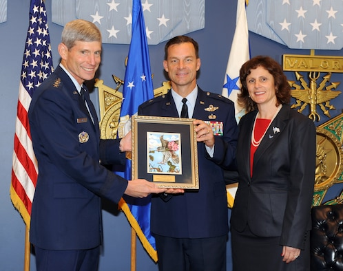Air Force Chief of Staff Gen. Norton Schwartz presents Brig. Gen. Mark and Sara Dillon with the traditional Gen. and Mrs. Jerome F. O'Malley Award legacy picture during a Pentagon ceremony Oct. 11, 2011, in Washington, D.C. The Dillons were honored with the award, presented annually to the wing commander and spouse whose contributions to the nation, Air Force and local community best exemplifies the highest ideals and positive leadership of a military couple in wing command positions. (U.S. Air Force photo/Andy Morataya)