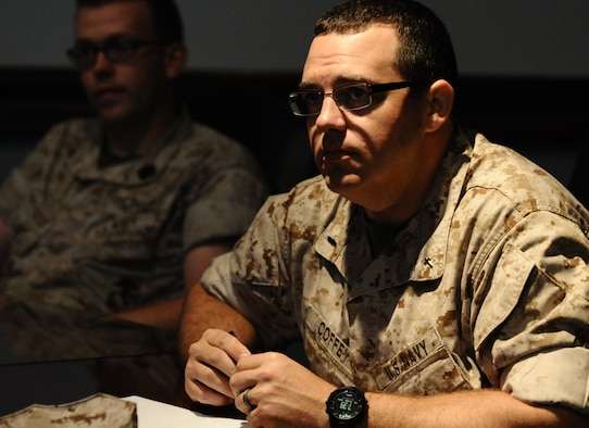 ANDERSEN AIR FORCE BASE, Guam—U.S. Navy Lt. j.g. Travis Coffey, deputy chaplain from Marine Aircraft Group 12, Marine Corps Air Station, Iwakuni, Japan, listens to the Andersen mission brief during a Pacific Airpower Tour here, Oct. 12. The tour gave U.S. Marines, U.S. Navy and U.S. Air Force members the opportunity to see what the total mission of Andersen Air Force Base is and what daily operations are performed around the base.  (U.S. Air Force photo by Senior Airman Benjamin Wiseman/Released)