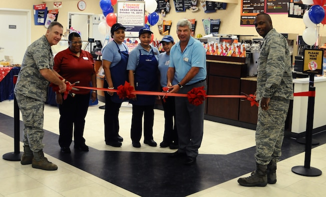 ANDERSEN AIR FORCE BASE, Guam—Leadership from Andersen cut the ceremonial ribbon with Exchange personnel during the grand opening of a Dunkin Donuts coffee shop here, Oct. 14. The Army and Air Force Exchange Service (AAFES) opted to put in a coffee shop after a receiving positive input from the base community. (U.S. Air Force photo by Senior Airman Benjamin Wiseman/Released)