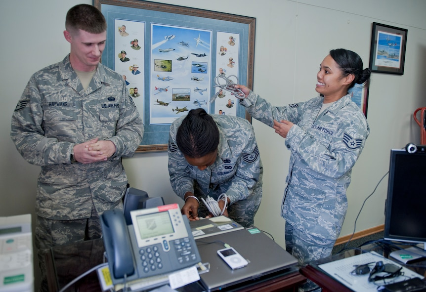 Staff Sgt. Chris Haymans, 39th Communications Squadron client systems technician, left, discusses a printer issue with Tech. Sgt. Lakiesha Williams, center, and Staff Sgt. Vanessa Kyota, both 39th Mission Support Group knowledge operations management technicians, Oct. 11, 2011, at Incirlik Air Base, Turkey. KOMT members are the liaisons between the Client Systems Team and the 39th MSG staff members for creating and ensuring completion of communications related trouble tickets. (U.S. Air Force photo by Senior Airman Anthony Sanchelli/Released)