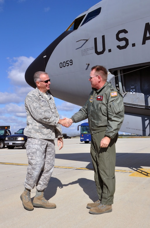 Brig. Gen. John E. McCoy, Assistant Adjutant General for Air, Wisconsin Air National Guard(left) welcomes home Col. Ted Metzgar, Commander, 128th Air Refueling Wing after returning from a 4-month long deployment in Western Europe on Friday, October 14, 2011 at Gen. Mitchell Air National Guard Base, Milwaukee. While deployed Metzgar served as the commander of the 313th Air Expeditionary Wing, supporting Operation Unified Protector. (U.S. Air Force photo/Capt. John P. Capra)