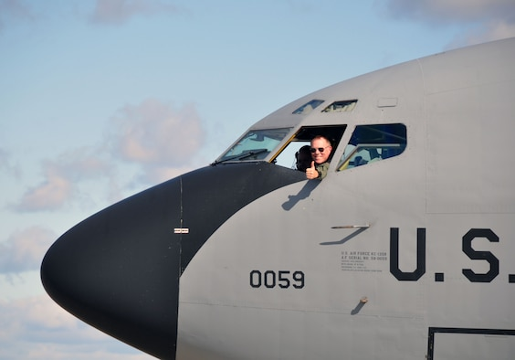"""Col. Ted Metzgar, Commander, 128th Air Refueling Wing signals """"thumbs up"""" as he returns from a 4 month long deployment supporting Operation Unified Protector in Western Europe Friday, October 14, 2011 in Milwaukee. (U.S. Air Force photo/Capt. John P. Capra)"""